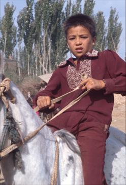 Young man at animal market in Kasgar, China.