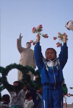 Young woman practicing for a celebration in Kasgar, China.