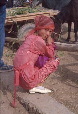 Young woman at animal market in Kasgar, China.
