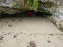 Crawling out from one of the caves.